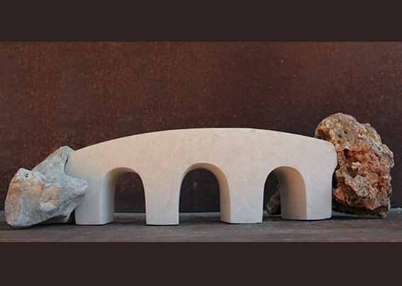 BRIDGE. sculpture by Emanuela Camacci in limestone ispired from the roman aqueducts